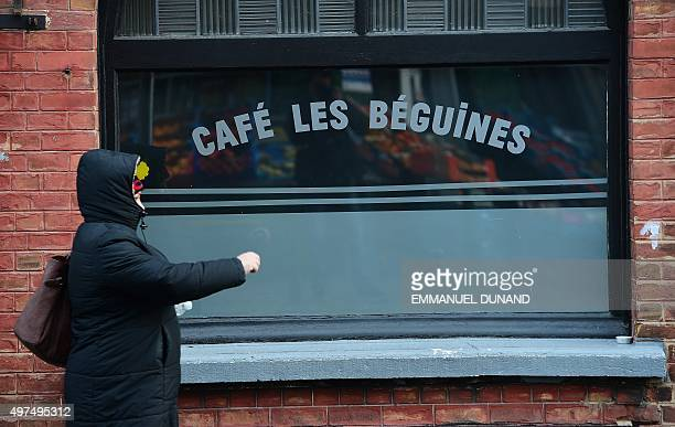 A woman walks past the bar Les Beguines owned by Brahim Abdeslam one of the suicide bombers implicated in the Paris attacks on November 17 2015 in...