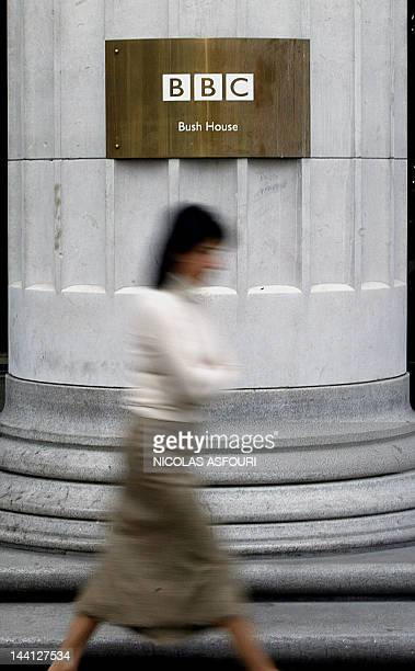 A woman walks past the BBC's Bush House in London 07 December 2004 The BBC said it would eliminate 2900 jobs or more than 10 percent of its workforce...