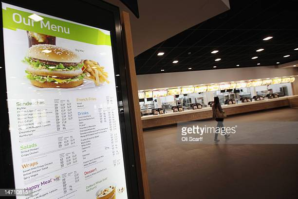 A woman walks past the checkouts in the world's largest McDonald's restaurant which is their flagship outlet in the Olympic Park on June 25 2012 in...