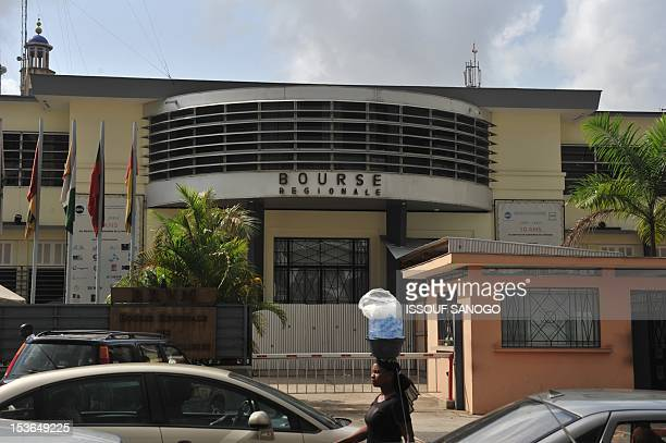 A woman walks past the closed regional stock exchange in abidjan on February 16 2011The Ivorian offices of French BNP Paribas affiliate BICICI and...