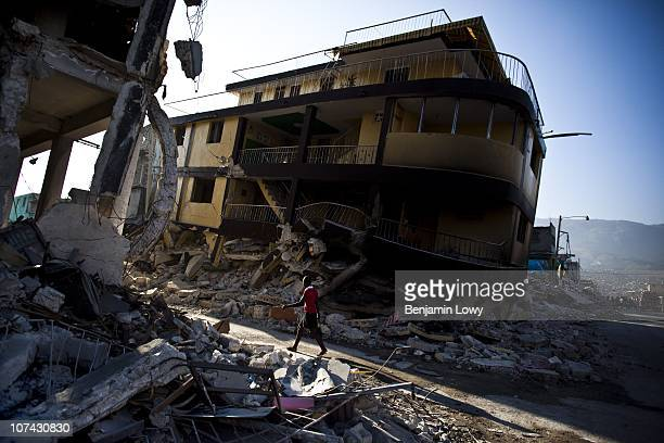 Woman walks past the collapsed buildings of downtown Port au Prince on February 4 2010. Haiti was struck by a magnitude 7 earthquake on January 12,...
