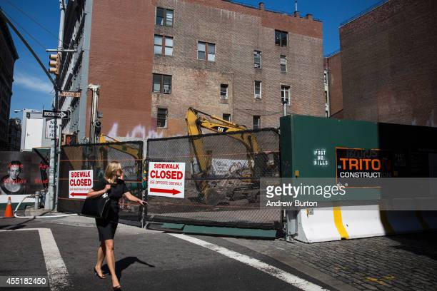 A woman walks past the construction site at 42 Crosby Street which is being developed into a luxury apartment building with 10 subterranean parking...
