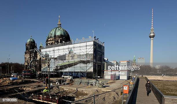 Woman walks past the construction site for an informational center about the reconstruction of the Berlin Palace in the city center on March 9, 2010...
