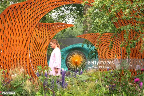A woman walks past the David Harber and Savills Garden during the RHS Chelsea Flower Show at the Royal Hospital Chelsea London