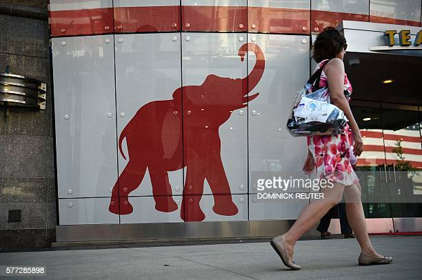 A woman walks past the elephant logo of the Republican Party on the first day of the Republican National Convention on July 18 2016 in Cleveland Ohio...