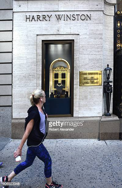 August 27, 2016: A woman walks past the entrance to the Harry Winston jewelry store on Fifth Avenue in New York City on August 27, 2016.