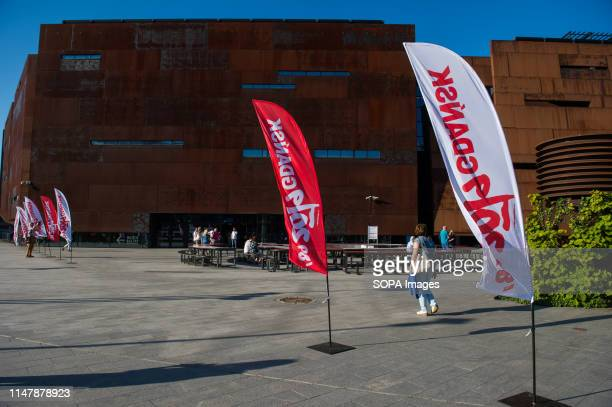 Woman walks past the European Solidarity Centre during the 30th Anniversary of free elections in Poland. Gdansk, in the 1980s became the birthplace...