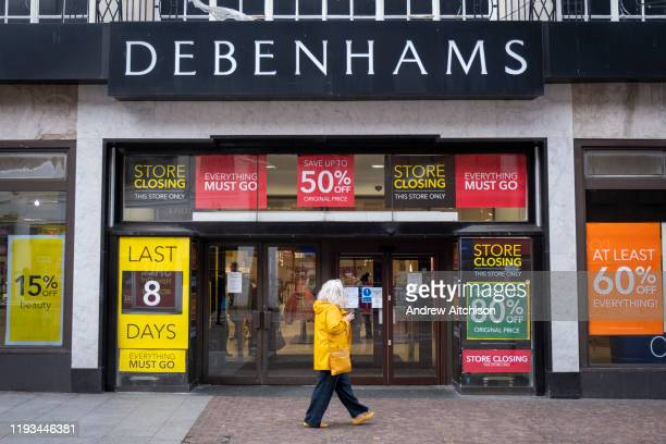 A woman walks past the Folkestone Debenhams store in the final few days of the Everything Must Go sale before closing down on 13th Jauary 2020 in...