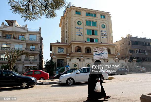 Woman walks past the headquarters of the Muslim Brotherhood on November 23, 2011 in Cairo, Egypt. A number of politicians have suspended campaigning...