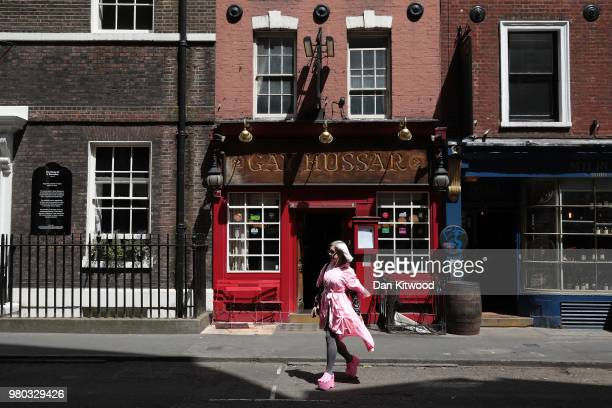 A woman walks past the Hungarian restaurant 'Gay Hussar' in Soho on June 21 2018 in London England The restaurant is due to close its doors tonight...