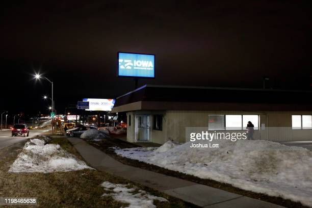 A woman walks past the Iowa Democratic Party building on Monday on February 3 2020 in Des Moines Iowa Results in the Iowa Democratic caucuses were...
