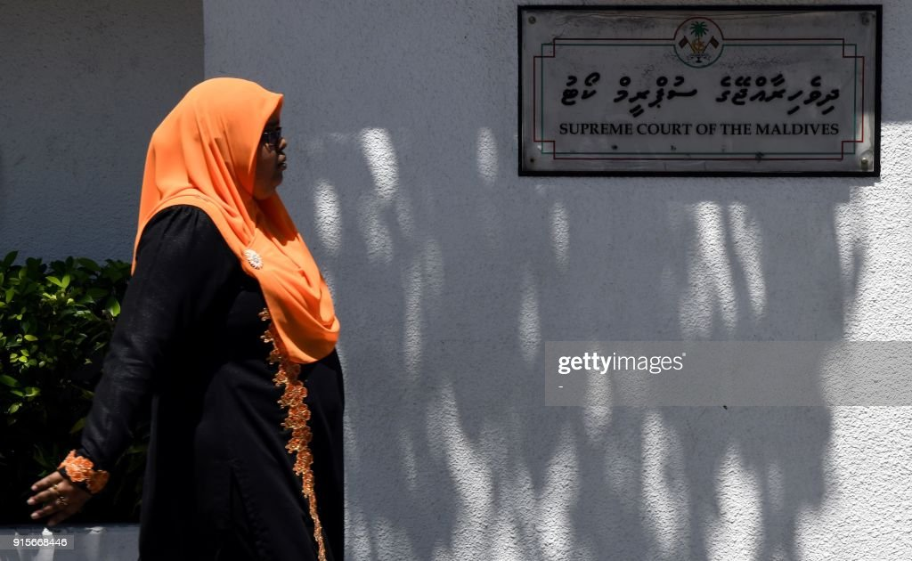 A woman walks past the Maldives Supreme Court building in Male on February 8, 2018. The international community has censured Maldives President Abdulla Yameen for imposing special emergency provisions that allow the military to detain suspects for long periods without charge. The UN has urged Yameen to lift the state of emergency, and will discuss the crisis gripping the Indian Ocean archipelago in a closed-door meeting at the Security Council on February 8. PHOTO / -