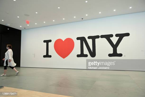A woman walks past the Milton Glaser I Love NY mural at the The Museum of Modern Art on August 27 2020 in New York City Museums and cultural...
