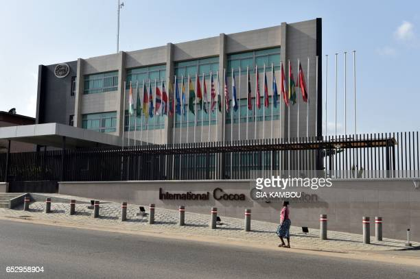 A woman walks past the new headquarters of the International Cacao Organization in Abidjan on March 13 ahead of a visit by the ICCO chairperson The...