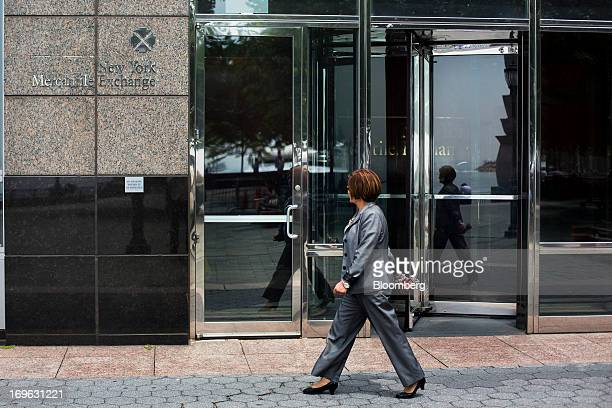 A woman walks past the New York Mercantile Exchange building in New York US on Wednesday May 29 2013 CME Group Inc the world's largest futures...
