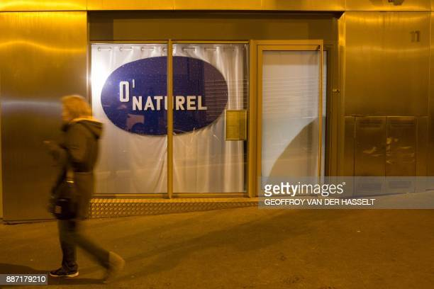 A woman walks past the newly opened nudist restaurant 'o'naturel' in Paris on December 5 2017 Leave your coats your pants and your inhibitions at the...