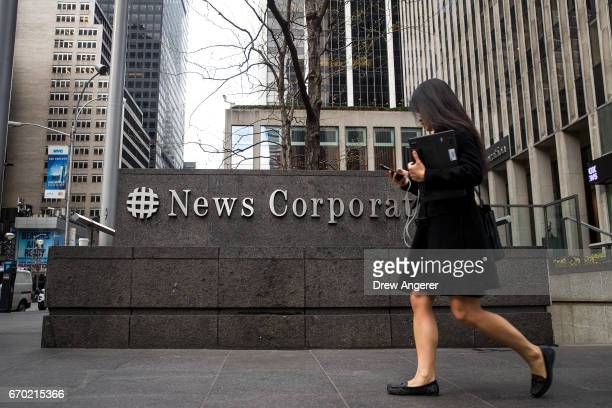 A woman walks past the News Corp and Fox News headquarters in Midtown Manhattan April 19 2017 in New York City Fox News television personality Bill...