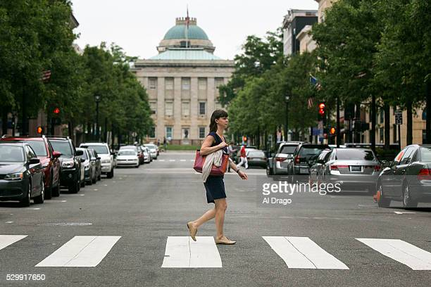 STATES MAY 9 A woman walks past the North Carolina State Capitol on Fayetteville Street in Raleigh NC on Monday May 9 2016 Gov Pat McCrory and his...