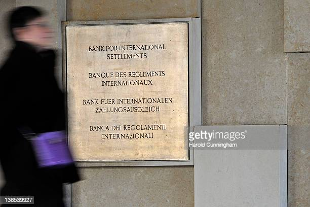 Woman walks past the plaque of the Bank for International Settlements on January 4, 2012 in Basel, Switzerland. The BIS is an intergovernmental...
