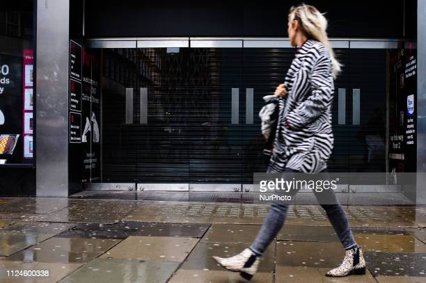 A woman walks past the recentlyclosed flagship branch of music and video retailer HMV on Oxford Street in London England on February 8 2019 February...