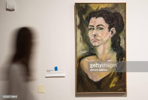 A woman walks past the self portrait by Carolee Schneemann at the exhibition 'Carolee Schneemann Kinetische Malerei' in Frankfurt/Main Germany 30 May...