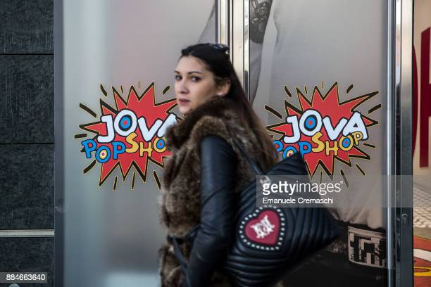 A woman walks past the windows of the 'Jova Pop Store' on December 1 2017 in Milan Italy Italian singer and songwriter Jovanotti opened a temporary...