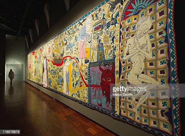 A woman walks past The Wolthamstow Tapestry 2009 a 15mt long tapestry by Grayson Perry on June 16 2011 in Venice Italy 'Penelope's Labour Weaving...