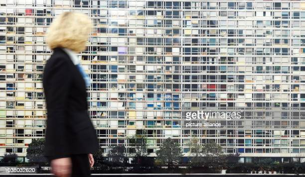 A woman walks past the work 'Paris Montparnasse' by artist Andreas Gursky at Museum Frieder Burda in BadenBaden Germany 02 October 2015 The art work...