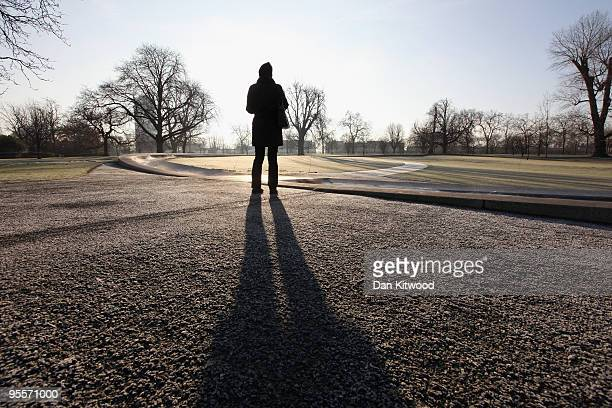 Woman walks round the frosty looking Princess Diana memorial in Hyde Park on January 4, 2010 in London, England. Much of the UK is in the grip of...