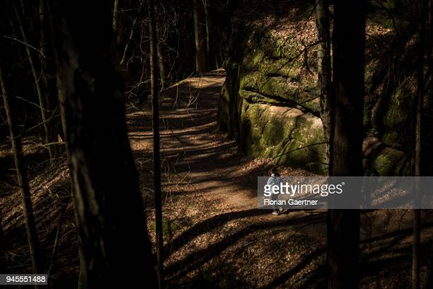 A woman walks through a forest in Saxon Switzerland on April 07 2018 in Rathen Germany