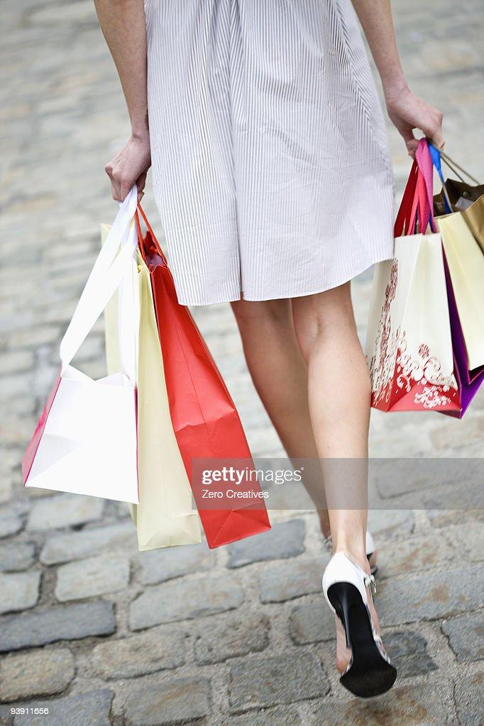 woman walks through a shopping street : Photo