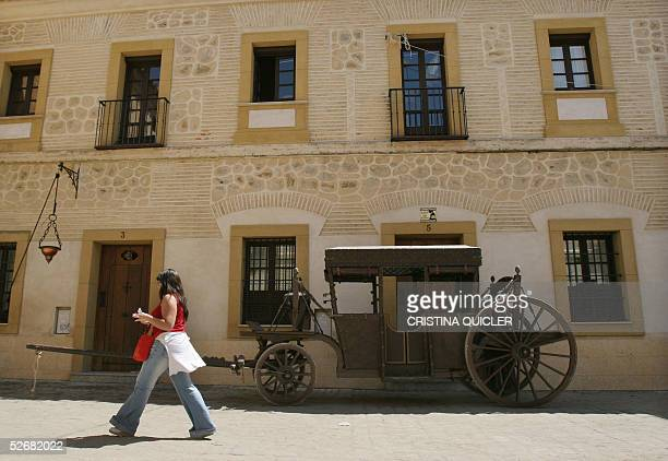 A woman walks through a square decorated for filming scenes of the movie 'Alatriste' by Agustin Diaz Yanes and starring Viggo Mortensen at ' La...