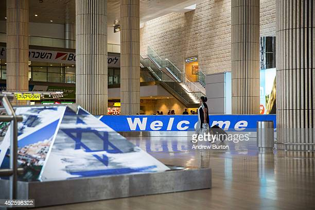 A woman walks through an empty arrivals gate at terminal three of Ben Gurion Airport on July 24 2014 in Tel Aviv Israel The Federal Aviation...