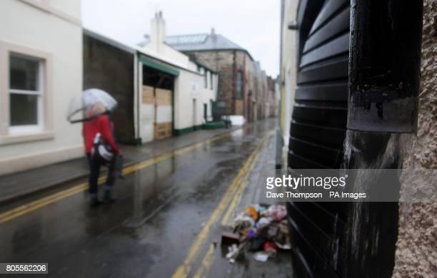Woman walks through Cockermouth town centre following the recent floods.