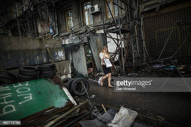 A woman walks through debris at a barricade near a makeshift campsite in Maidan Nezalezhnosti better known as Independence Square on May 21 2014 in...