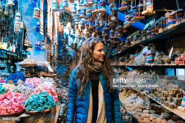 woman walks through local small shop - souvenir stock pictures, royalty-free photos & images