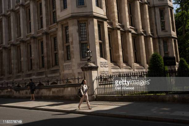 A woman walks through sunshine on Chancery Lane on June 27 2019 in London England Temperatures in southeast England are set to soar with thunderstorm...