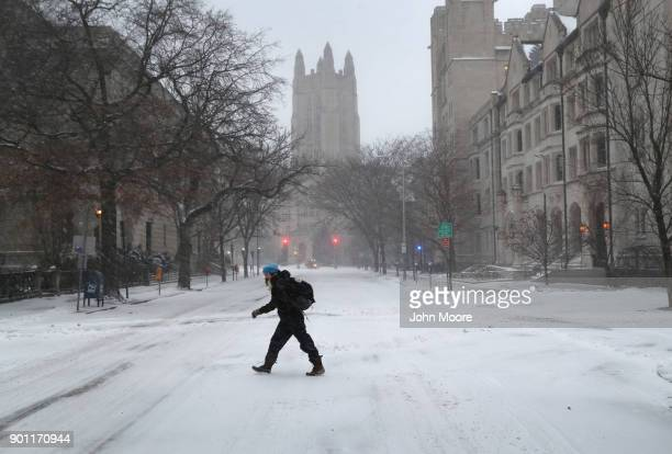 A woman walks through the campus of Yale University on January 4 2018 in New Haven Conneticut The bomb cyclone was expected to dump heavy snows in...