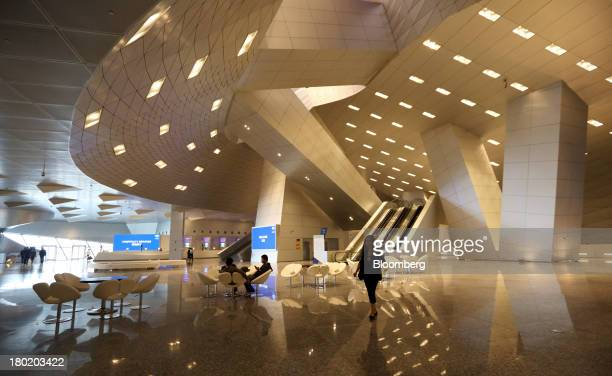 A woman walks through the Dalian International Conference Center in Dalian China on Tuesday Sept 10 2013 The World Economic Forum Annual Meeting Of...