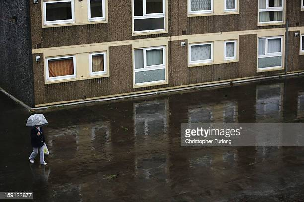 A woman walks through the Falinge Estate which has been surveyed as the most deprived area in England for a fifth year in a row on January 8 2013 in...