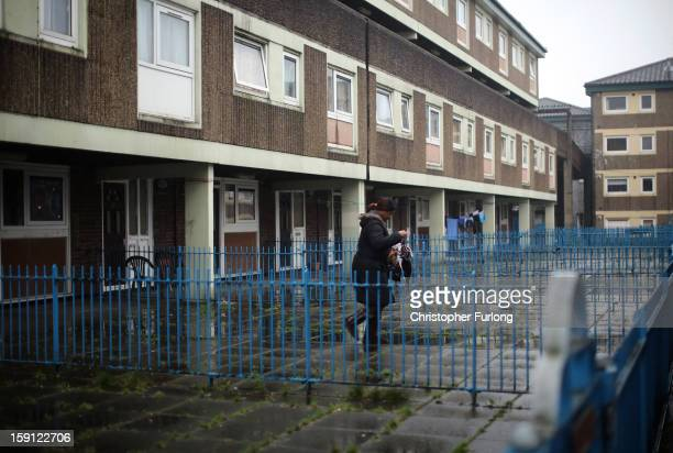 Woman walks through the Falinge Estate, which has been surveyed as the most deprived area in England for a fifth year in a row, on January 8, 2013 in...