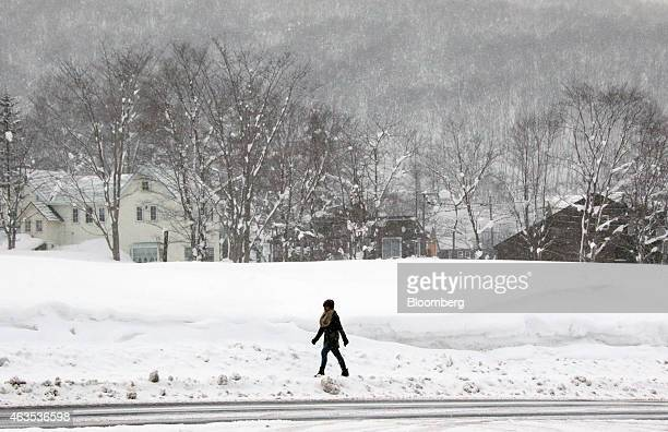A woman walks through the Hirafu area of Kutchan Hokkaido Japan on Saturday Feb 14 2015 Japan had a record number of foreign visitors in 2014...