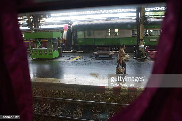 A woman walks through the Hua Lamphong Railway Station on August 1 2014 in Bangkok Thailand Thai officials have relaunched women and children only...