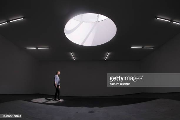 A woman walks through the installation 'Nachtag'  by Micha Ullmann at the museum in Wiesbaden Germany 06 May 2013 After almost four years of redesign...