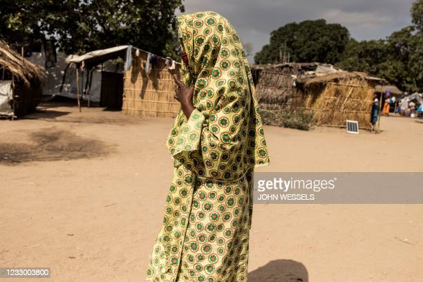 Woman walks through the Internally Displaced Person camp '25 de junho', in Metuge on May 20, 2021. - '25 de junho' is one of the most populated...