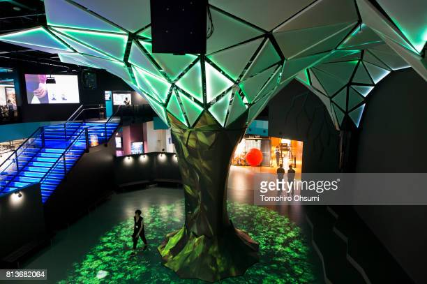 A woman walks through the main lobby of the VR Zone Shinjuku theme park operated by Bandai Namco Entertainment Inc on July 13 2017 in Tokyo Japan The...