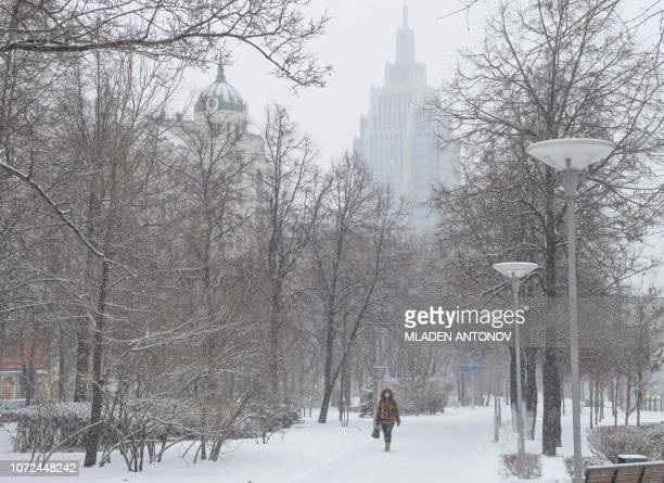 A woman walks through the snow in downtown Moscow on December 13 2018