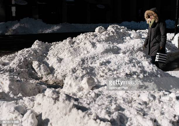 A woman walks through the snow the morning after a massive winter storm on January 5 2018 in Boston United States Schools and businesses throughout...