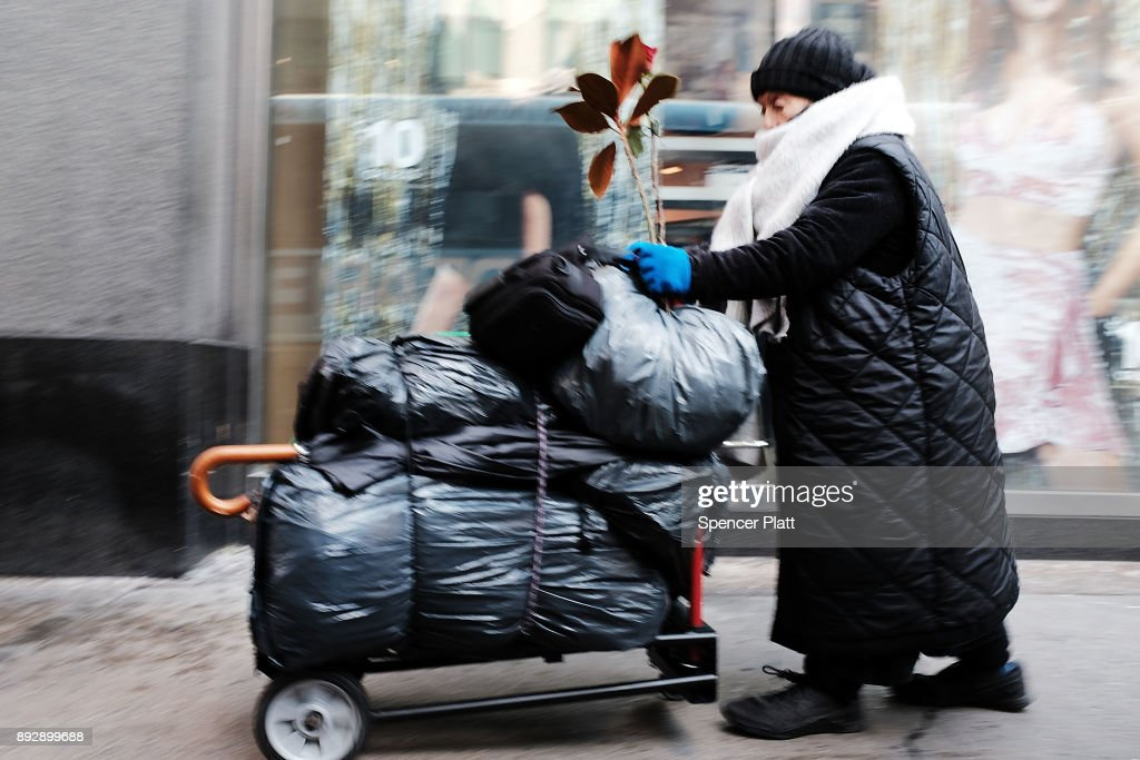 A woman walks through the streets of Manhattan with her belongings on December 14, 2017 in New York City. According to a new report released by the U.S. Department of Housing and Urban Development New York City's homeless population expanded by about 4 percent in 2017 as the number of homeless people nationwide grew to about 553,000.