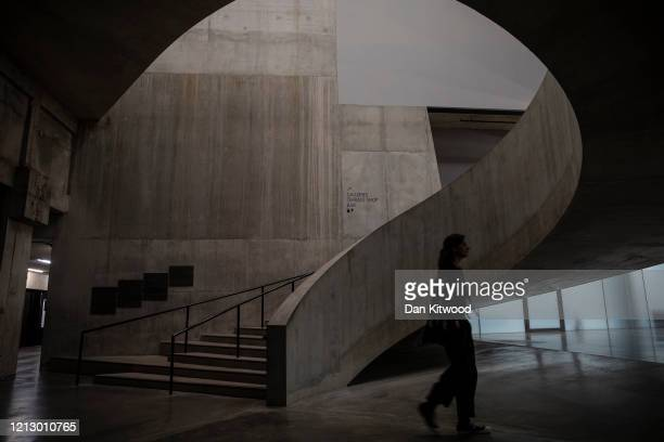 Woman walks through the Tate Modern on March 17, 2020 in London, England. The Tate Modern has announced it will close it's doors from tomorrow amid...